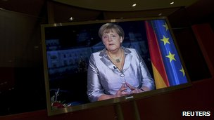 Merkel warns of tough times ahead
